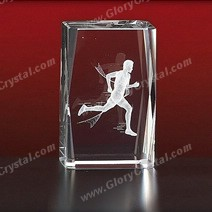 runner crystal paperweight